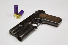 KingsmanPistol a modified Russian Tokarev TT-30 pistol. The prop master added a shotgun barrel. Made by Cohort Film Services in Amersham, United Kingdom  https://www.intellihub.com/wp-content/uploads/2015/02/kingsman-image.jpg  http://www.heroprop.com/wp-content/uploads/2015/09/Kingsman-lancelot-pistol-wallpaper-1024x576.jpg