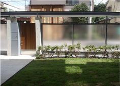 This is a great Japanese house from Kidosaki that has a mid century twist. The concrete finish blends really well with the opaque glass to create an intriguing image of what's behind. Dark grays plus the golden color front door makes this residence stand apart from the rest but at the same time brings calm with the typical Japanese clean interior.