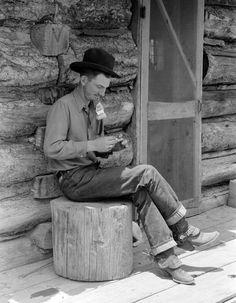 Cowboy, 1940s, hand rolling a smoke