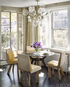 Marisa Tomei NYC apt photo by Douglas Friedman dining nook vintage marble table Lindsey Adelman chandelier