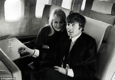 John Lennon, pictured with his first wife Cynthia Lennon, on a plane in New York in February 1964