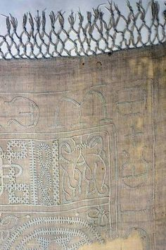 A fragment of cloth, Europe, 13th century. Tablecloth decorated with fringe, embroidery and openwork.