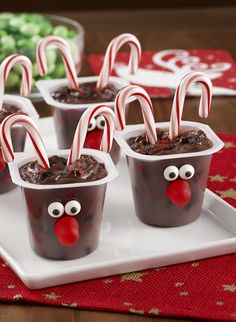 Reindeer Candy Cane Pudding Cups - a kid-friendly dessert recipe that will make everyone smile. Cookies stirred into chocolate pudding and decorated like Rudolph make for fun Christmas treats.