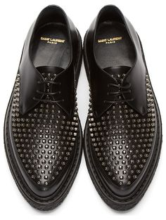 BLack Leather Studded Creepers by Saint Laurent. Buffed leather creepers in black. Almond toe. Tonal lace-up closure. Gunmetal-tone studs at tongue and toe. Crepe rubber sole. Tonal stitching.  http://www.zocko.com/z/JJXBl