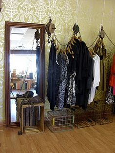 using old pulleys and chain for a clothing display
