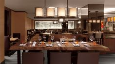 Community tables at Parallel 37 are perfect for gathering a group of friends and family at The Ritz-Carlton, San Francisco.