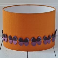 Burnt orange silk lampshade with a row of individually hand made purple butterflies. x silk, .