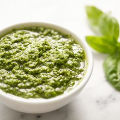 Homemade pesto is one of the best ways to enjoy a bounty of fresh basil. This basil pesto recipe from Simply Recipes uses pine nuts, garlic, Parmesan or Romano cheese, and extra virgin olive oil. Make it in just 15 minutes! Fresh Basil Pesto Recipe, Basil Pesto Sauce, Basil Pesto Recipes, Green Bean Pesto Recipe, Pasta Recipes, Cilantro Pesto, Tomato Pesto, Whole Wheat Noodles, Green Beans Almondine