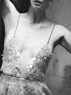 Sheer dress detail with delicate layered embellishments; couture sewing inspiration