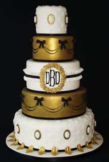 black and white and gold wedding cakes | Posted on: December 11th, 2010 by