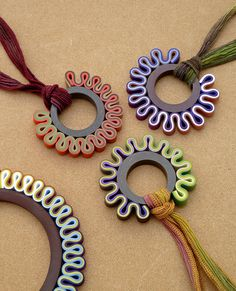 Polymer pendants by  Carina Feichtinger aka Carina's Clay Creations. Carina is always coming up with unique things to do with clay. Very creative and beautiful.
