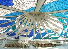 Catedral Metropolitana Nossa Senhora Aparecida, located in the capital of Brazil, is the work of architect Oscar Niemeyer. The hyperboloid structure with glass ceiling, surrounded by concrete columns. Completed in 1970.