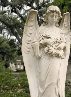 Bonaventure Cemetery, Savannah, Georgia.  I have taken so many images of this alabaster statue.  This angel's face is so sad.  The detail and workmanship is stunning.  From the sadness in her eyes, to the folds in her robe, the artist did a moving piece.