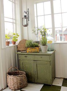 sage green cabinet
