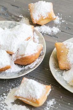 top down shot of powdered beignets Just Desserts, Delicious Desserts, Dessert Recipes, Yummy Food, Donut Recipes, Brunch Recipes, New Orleans Beignets Recipe, Comida Disney, Beignet Recipe