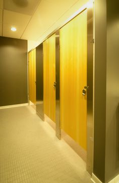 Ironwood Manufacturing wood veneer bathroom doors with metal toilet partitions. Beautiful, clean public restroom stalls.