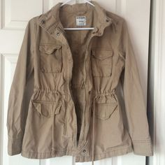 Tan Utility Cargo Jacket Tan utility cargo jacket from old navy. Perfect condition gently worn! It's wrinkly because it has just been laying around unworn, if you'd like me to iron it if purchased feel free to ask! It has an adjustable waist and 4 pockets. Old Navy Jackets & Coats Utility Jackets