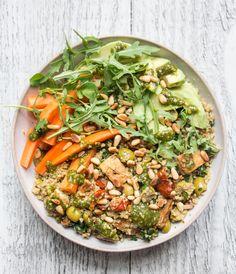 Quinoa with pesto, sautéed tofu, pine nuts, rocket (arugula), avocado and carrots