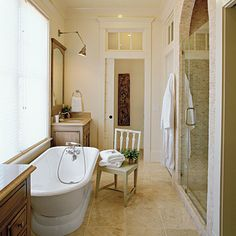 Interesting architectural elements - arched topped shower and windows above the door