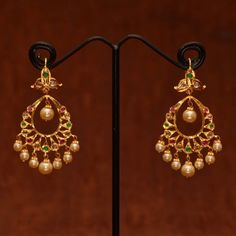 Shop Anvi\'s Chand Bali Studded With Uncut Stones, Emeralds And Rubies With Pearl Hangings by Anvi Collections online. Largest collection of Latest Earrings online. Gold Jhumka Earrings, Indian Jewelry Earrings, Jewelry Design Earrings, Gold Earrings Designs, Antique Earrings, Chand Bali Earrings Gold, Gold Designs, Small Earrings, Pendant Jewelry