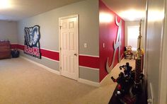 My boys' Alabama crimson tide bedroom. This is the west wall and dormer.