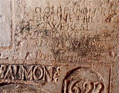 T. Salmon, 1622. Above his coat of arms, he scrawled,  CLOSE PRISONER 32 WEEKS, 224 DAYS, 5376 HOURS. He is believed to have died in custody.