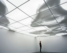 "Continent-Cloud"", by Rivane Neuenschwander, is an illuminated ceiling on which beans are pushed around by intermittently placed fans, and the roof of the gallery morphs into moving landmasses or shapes."