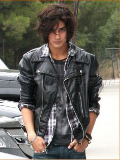 "(FC: Avan Jogia) Hello everyone, I'm Thatos ""Quartmaster"" Patel, hailing from India. I'm a dagger user, meaning that my marksmanship is on point, however, my ability to climb is not. I'm known as the King of the Academy, being outgoing, bold, and basically, the best. I came from India after my family was killed, and their dying wish was to see the Élan defeated, and I will do it with my own daggers. I'm 20 years old."