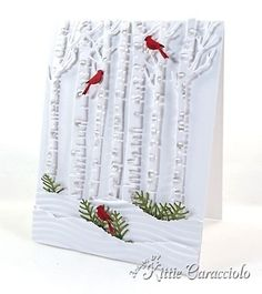 Good Tuesday morning. I have been having lots of fun this holiday season making mostly all white card with small pops of color. It intrigues me how just a few little pieces of color can make such a bold statement...