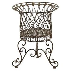 """Create a beautiful outdoor oasis with this summer-ready essential, an enviable addition to your patio or garden.   Product: PlanterConstruction Material: MetalColor: Light brownDimensions: 15.75"""" H x 12.5"""" Diameter"""