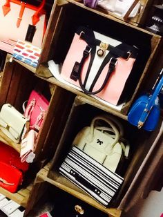Rustic display of handbags, clutches and wallets in our shop.