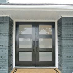 Black front doors with painted brick