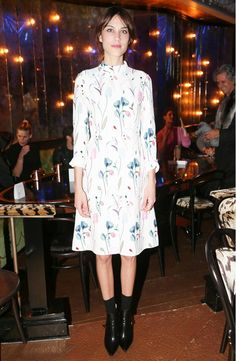 Alexa Chung in a floral dress and black ankle boots