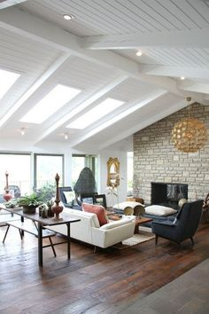 Stone fireplace, exposed beams by sososimps
