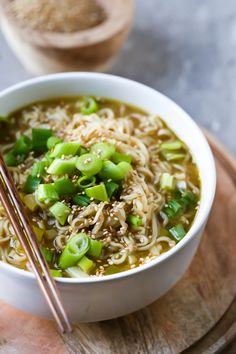 A delicious Easy Homemade Ramen Noodle Soup that is actually healthy, vegan, oil-free and full of fresh ingredients like ginger, garlic and green onions! Only 8 ingredients! You'll never need packet ramen noodles again! Don't bite the screen! Don't do it! I know that big fat pasta closeup is shouting 'eat me!' but I don't want you to chip a