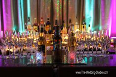 THE BAR all set & ready for the 1st guest at The Mirage Banquets in Schiller Park. Colorful up-lighting adds the right amount of pizazz to kick off the evening. Photographed by The Wedding Studio, Schaumburg IL