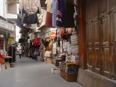 Manama Souq Bahrain. Loved shopping in the Souq, but we had to be proper in dress and respect the people and their cultures. Bought a lot of gold rings and bracelets. Wish the children had been a little older so that they would have some memories of Manama. They do remember our houseboy,Shombie, the most. That poor man had to clean and sit with the children while I was busy doing what the officers wives did...