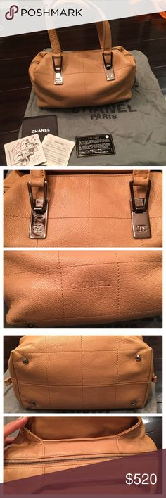 """CHANEL Leather """"East West"""" Top Handle Satchel Preowned taupe brown Chanel leather satchel. Vintage bag. Minor wear scruff on the bottom corner. Exterior has minor scratch and very small markings. The metal hardware has minimal scratches. Handle stitching is pulling a bit at the end. Middle zipper with two side outer compartments. Interior is clean with a bit dust due to years in dust bag. Inside zipper handle do come off if tug too hard. Only comes with authenticity card and mini book. Bag…"""