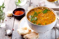 SPICY LENTIL SOUP  Place 1½ cups red lentils,  4 cups vegetable stock, 2 diced tomatoes, 1 tsp Celtic Salt in a pot. Heat 1 tbsp coconut oil, add 1 tsp mustard, 1 tsp cumin seeds. Fry for 10 seconds. Reduce the heat, and add 2 green chilies, 2 tsp chopped garlic and ginger. Fry for 20 seconds. Add ½ cup chopped onion and fry. Add some turmeric, chile powder, coriander, cinnamon.Combine all ingredients and bring it to a boil. Cover & simmer for 20 minutes. Serve with fresh chopped cilantro.