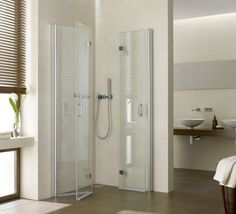Foldable Shower shower doors fold back to open up the bathroom/ laundry room until