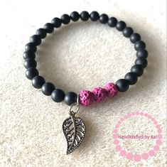 Matted Onyx Stretch Bracelet with Fuchsia Pink Lava Beads and Leaf Charm; Essential Oil Diffuser Bracelet by handkraftedbykat on Etsy