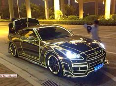 TRON themed Nissan GT-R! Beautiful piece of machinery!