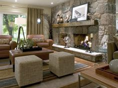 Modern rustic mantle. Light brown leather club chairs and ottoman. Lots of seating for family gatherings.
