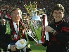 Alex Ferguson (left) and assistant manager Brian Kidd hold the 1993/94 Premiership trophy after the final match against Coventry City.