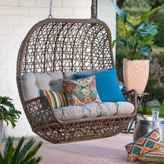 Blending casual and retro style, theBelham Living Rayna All Weather Wicker Loveseat Porch Swing with Cushion adds a cozy seating option for two to your porch or covered patio. Cuddle up on the plush gray cushion with a loved one or a good book. Farmhouse Porch Swings, Wicker Porch Swing, Porch Bench, Wicker Porch Furniture, Wicker Couch, Wicker Trunk, Wicker Headboard, Wicker Mirror, Wicker Shelf