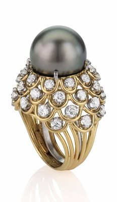 A Cultured Pearl and Diamond Ring by David Webb:  Centering upon a cultured Tahitian pearl measuring approximately 14.40 mm, to the scalloped open-work gallery enhanced by circular-cut diamonds, and open wirework hoop, mounted in 18K yellow gold and platinum, size 5.  Signed 'Webb'. Via Philips.