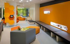 The waiting room in the emergency department, which serves approximately 70,000 visitors a year, features digital entertainment, inserts to display art, and a children's play area. Credit: Christopher Frederick Jones