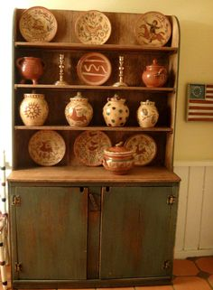 gorgeous combination of Jane Graber's redware pottery displayed in Joanna Scarboro's country cabinet