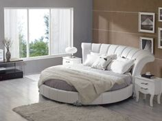 One of my favs...curved head board gorg Contemporary round bedset helps create exquisite interiors