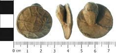 A cast, lead alloy medieval button (probably), dating from 1400-1550. The upper surface is slightly domed and is decorated with a pattern of...